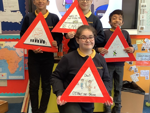 Year 6 made road signs to help child stay aware of safety outside school.