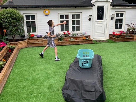 Some lovely pictures of a Y6 pupil completing sports day activities, in his garden...