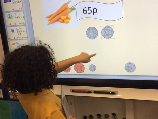 In Monkey class the children have been using the interactive whiteboard to help them with their...