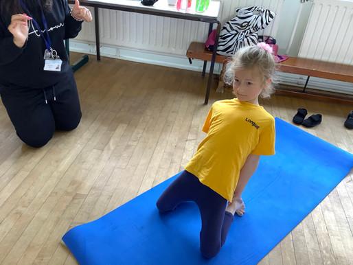 Year 1 at 2 are enjoying taking part in Yoga Bugs.
