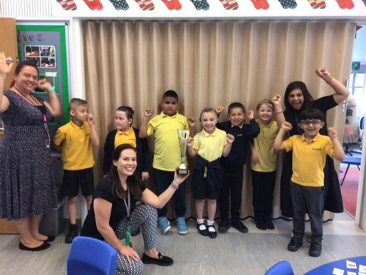 Key Stage One pupils won the orienteering competition. This is Year 2 receiving the trophy.