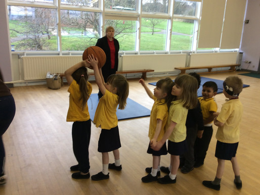 Reception pupils are learning how to throw and kick a ball correctly...