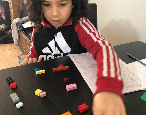This pupil in Flamingo class has been using LEGO blocks to help with his Maths work.
