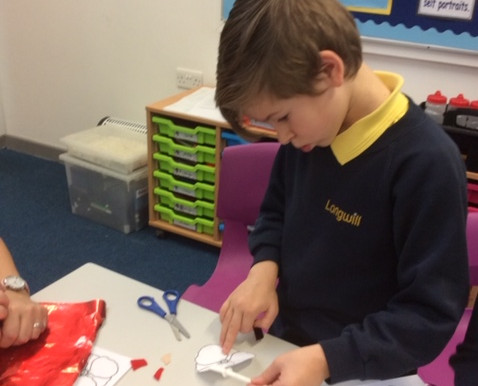 Year 5 Tulip Class creates poppy pictures when learning about remembrance