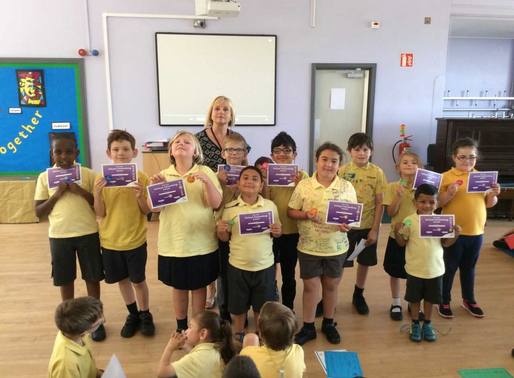 Pupils are rightfully proud of their achievements as they receive their swimming certificates at our