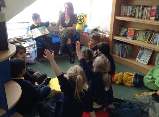 Year One enjoying a signed story in the library.
