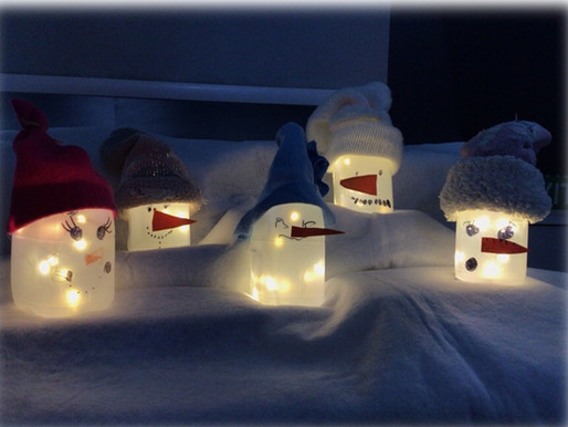 Hedgehogs have created snowman lanterns using recycled milk cartons. We think they look Magical.
