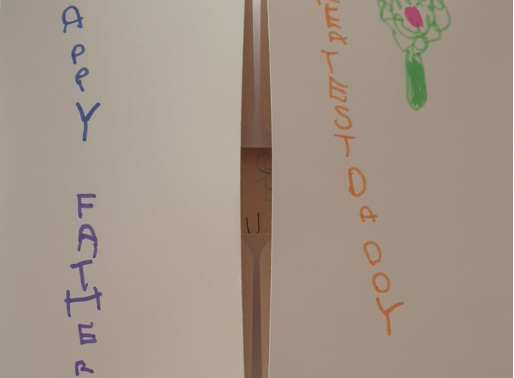 A Y4 pupil has used a cake box to make his Father's Day card..