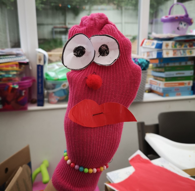What a lovely sock puppet. Made by a pupil in Foundation.