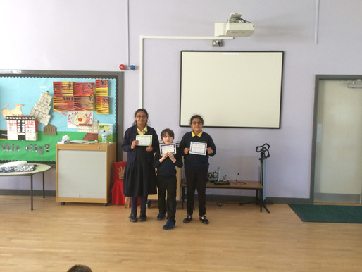 Congratulations goes to these three pupils as they receive their swimming certificates....