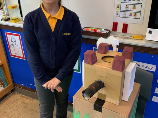 Crocodiles class are very proud of their work for the Longwill School Art Gallery.