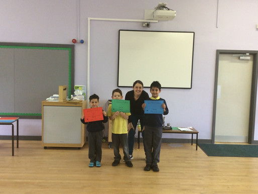 Key Stage One pupils were proud to receive their achievement certificates...