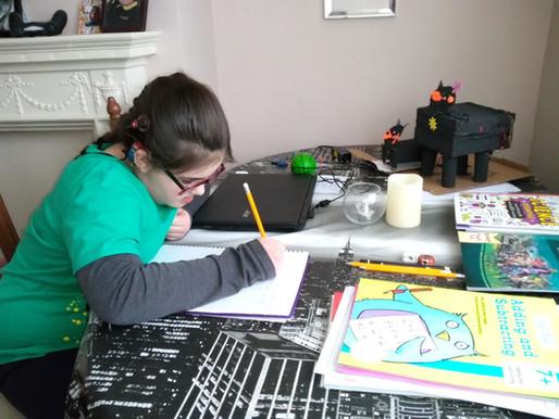 A year 5 pupil, hard at work..