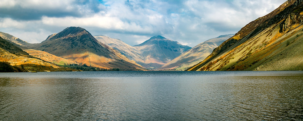 Wide panoramic view of mountains and lak
