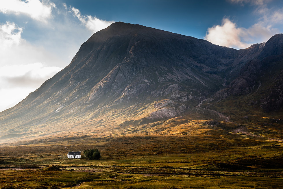 Isolated house surrounded by mountains i