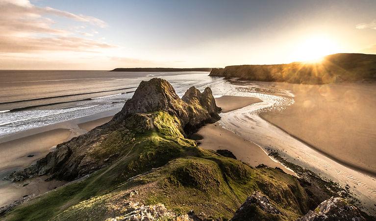 Panoramic of suntset at Three Cliffs in
