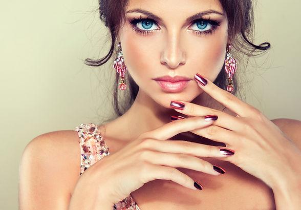 Beautiful model girl with pink metallic