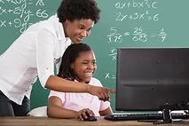 Smiling African Teacher Teaching Her Stu