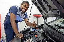 Good Looking Mechanic Giving Thumbs Up A