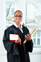 Young female lawyer working in her offic