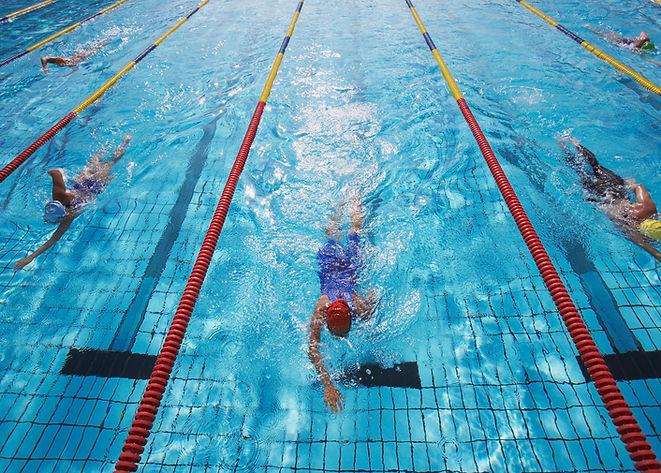 people swimming laps