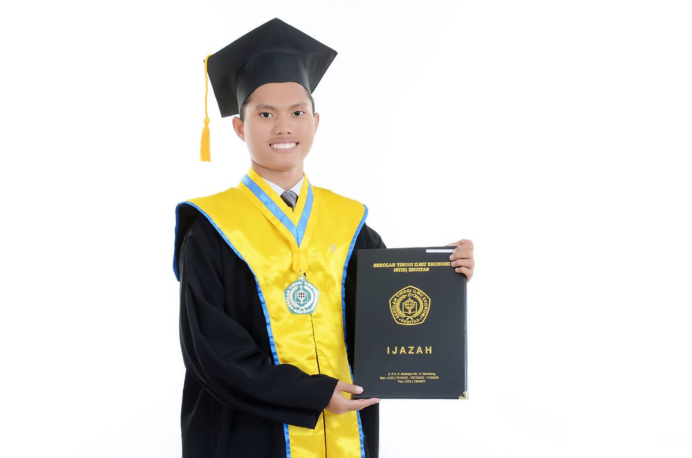 Me holding my diploma