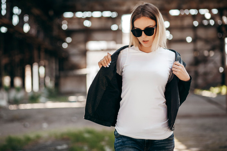 Girl wearing t-shirt, glasses and leathe