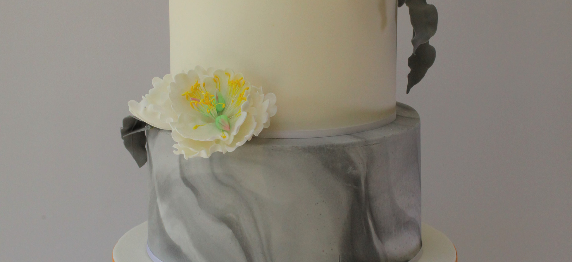Marble and gold cake with sugar peonies