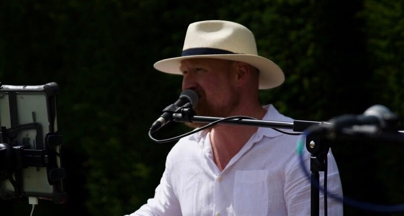 Andrew James performing at a festival