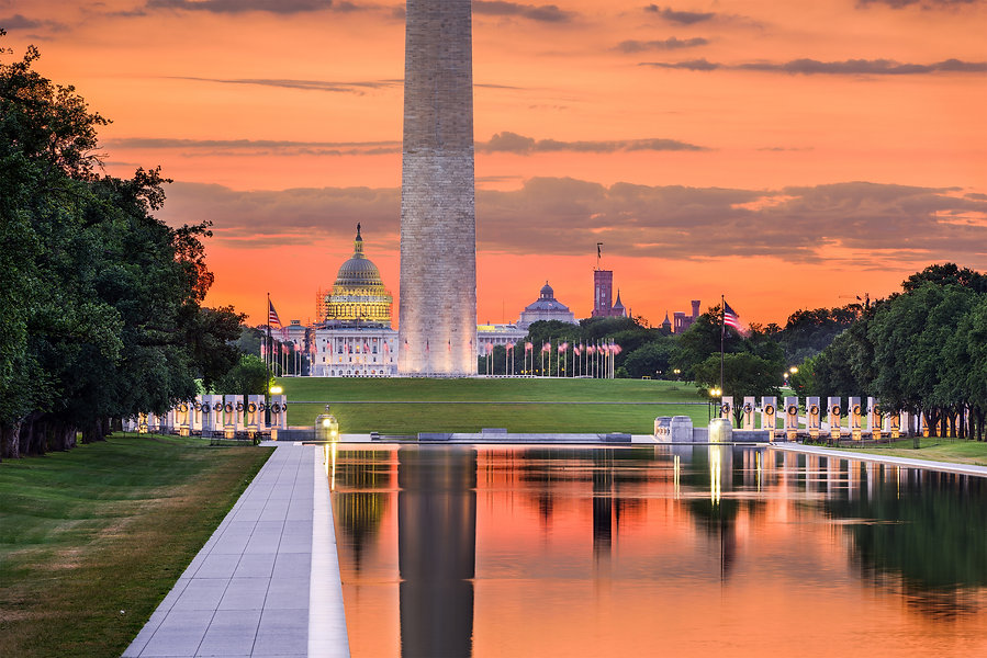 Washington Monument and Capitol Building from the Reflecting Pool in Washingon DC, USA..jpg