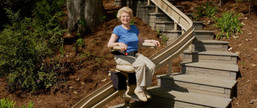 Outdoor-Curved-Stairlift-lady-riding2-PG
