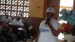 D4Africa Ambassador Sierra Leone giving refugees birth certificates 1.jpeg