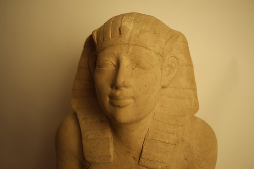 EGYPTIAN LIMESTONE STATUE OF A KNEELING PHARAOH AFTER THE ANTIQUE