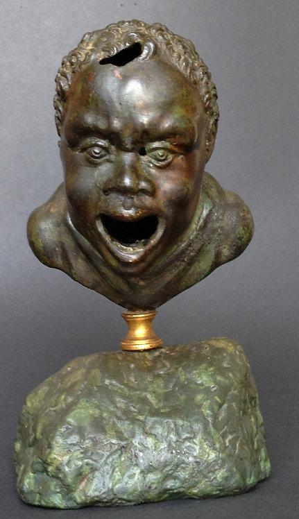 A Renaissance after a Roman Bronze Oil Lamp Head of a Nubian