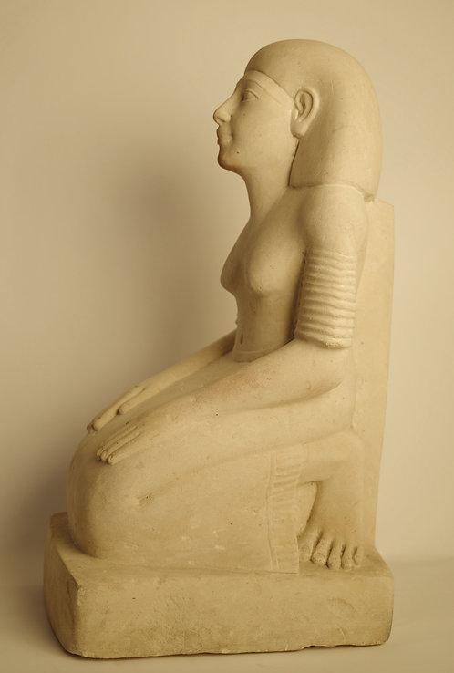 EGYPTIAN LIMESTONE STATUE OF A KNEELING LADY IN PRAYER