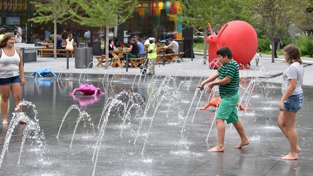 Children enjoy the splash pad located on the Cleveland Foundation Centennial Plaza on Public Square's southern half.
