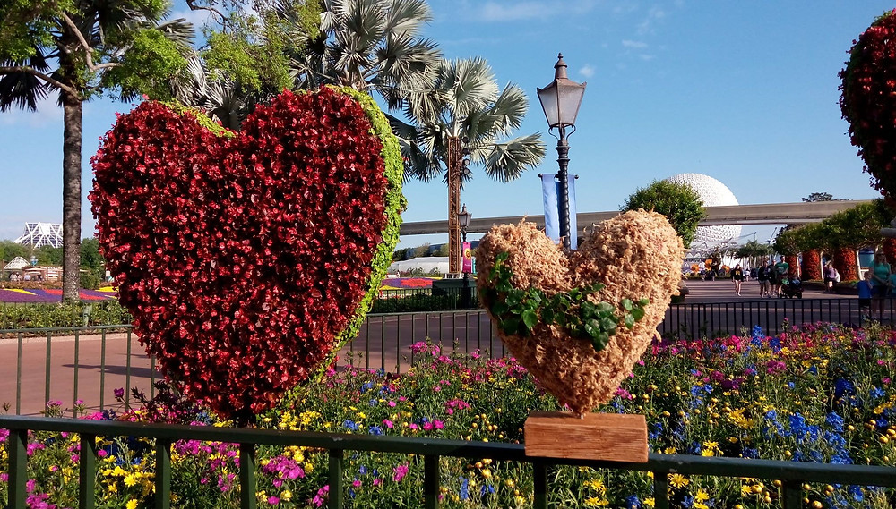 Heart topiaries with the spaceship earth ball in the background.