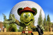 Mickey Mouse Topiary with the Epcot silver ball in th backgroud.