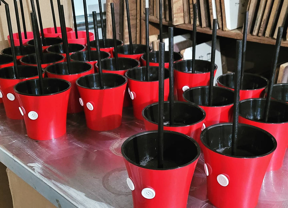 More Mickey Head planter pots on a table being worked on.