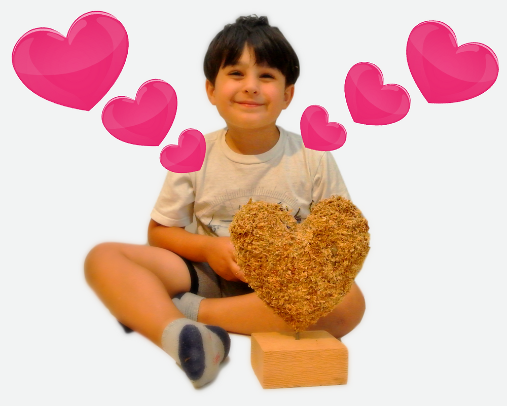 Our son with the small heart topiary. Stuff only version.