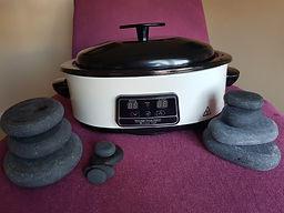the stone warmer and a selection of various sized basalt stones thatare used for hot stone massage