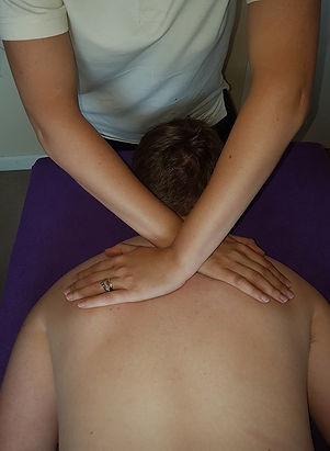 Client receiving myofascial release over the shoulder blades