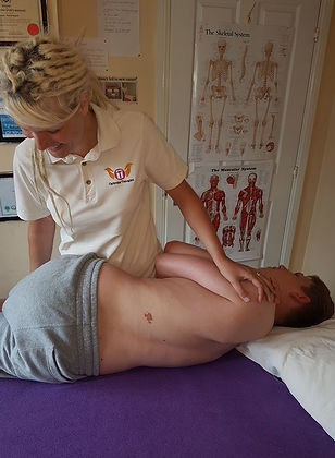 Susan performing a back roll for a client