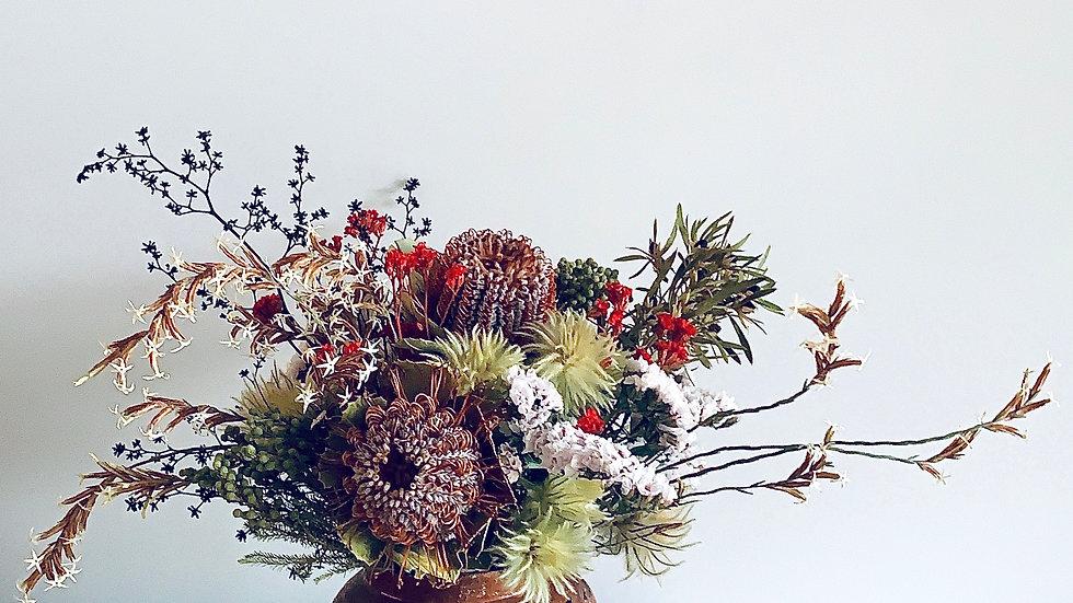 Wildflowers in pottery vase