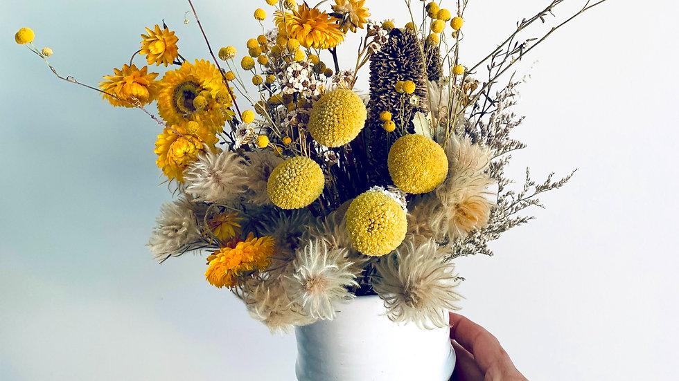 Yellow wildflower pot