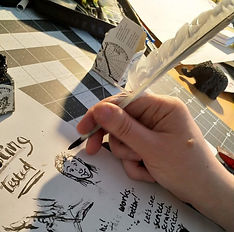 Feather Quill and ink in action