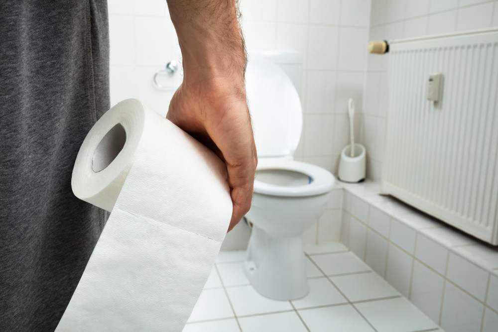Man going to toilet because of Bowel incontinence or Bowel leaking
