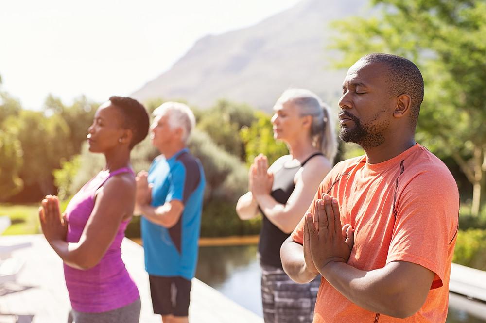 Mature individuals practicing yoga
