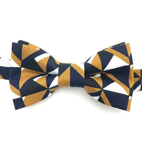Noeud papillon motifs géométriques noirs, moutarde, beiges et blancs.