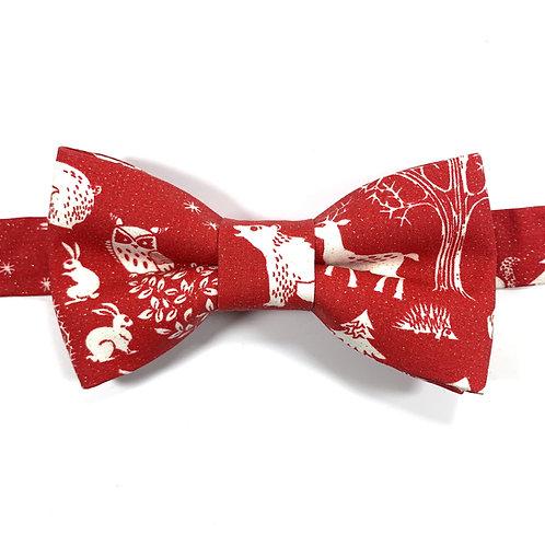 Noeud papillon rouge aux motifs d'animaux de la forest blancs et paillettes ors.